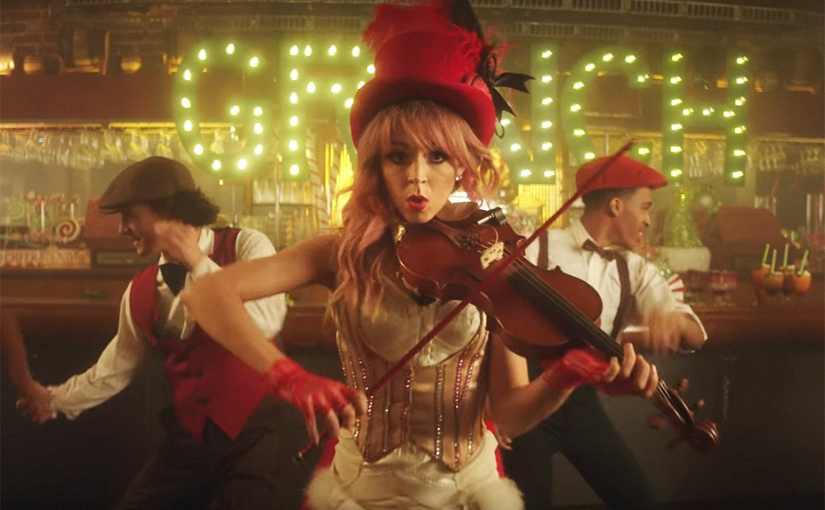 "Listen To Lindsey Stirling's ""You're A Mean One, Mr Grinch"" Featuring Sabrina Carpenter"